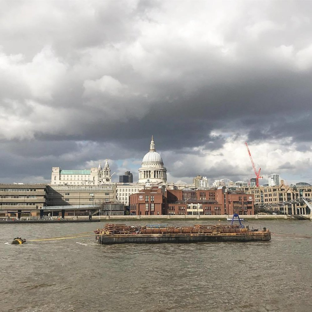 A snow-threatening sky over a bustling Thames River.  -  #unitedkingdom #england #london #thames  (at London, United Kingdom)