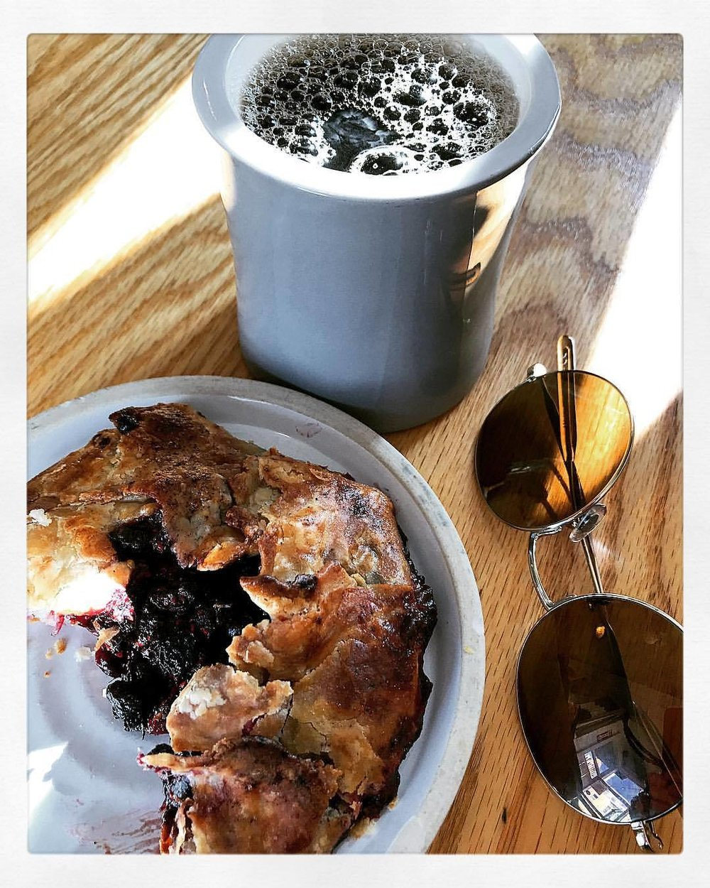 New England breakfast fare:  wild Wellfleet berry galette and dreamy black coffee from Portland, Maine.    -  #massachusetts #tandemcoffee #capecod #provincetown  (at The Canteen)