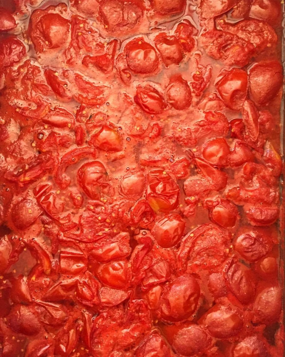 One-hundred pounds of dry-farmed Early Girl tomatoes 🍅 cooked over wood, milled and jarred.    -  #nutsforwinter #sauce #manyhandsmakelightwork  (at Napa, California)