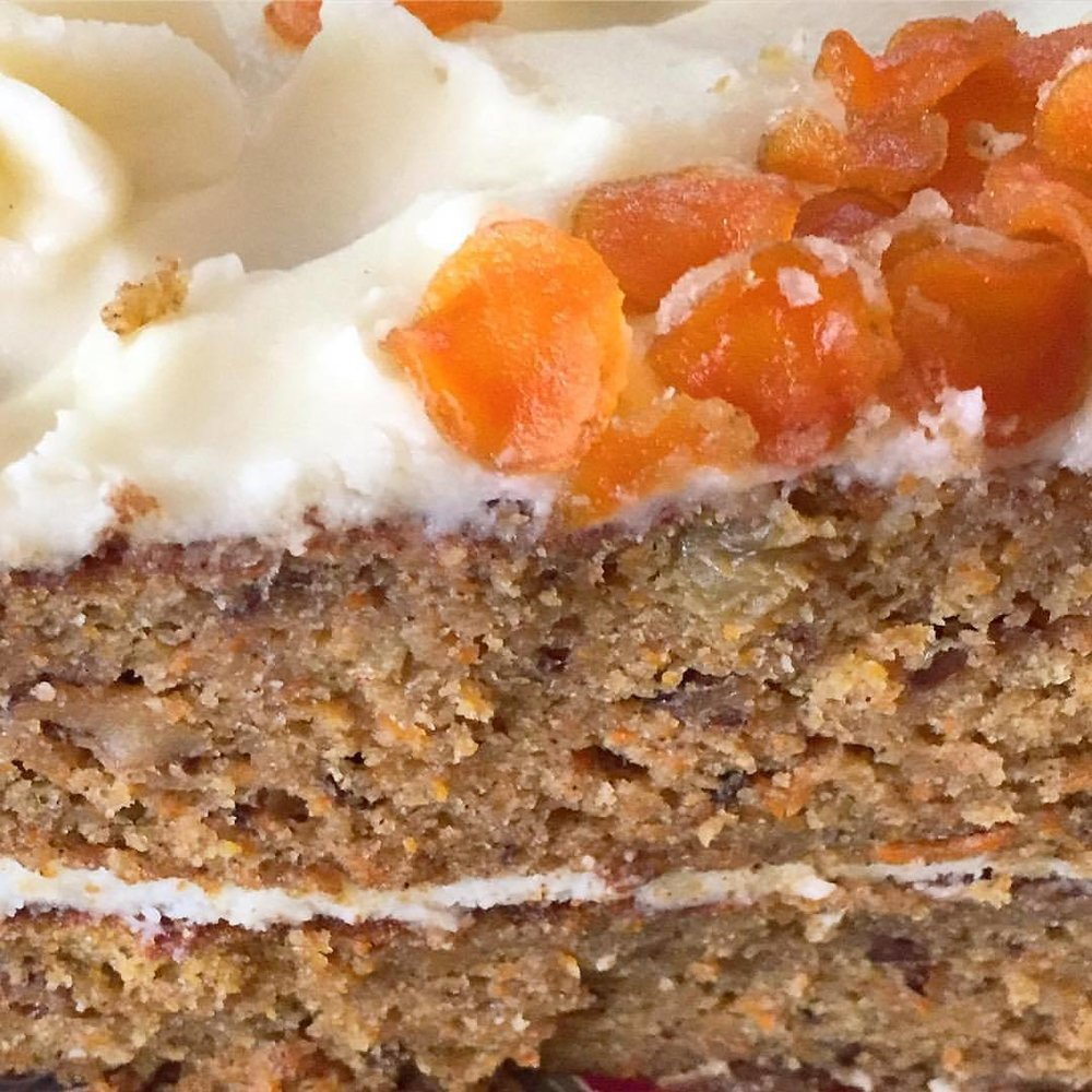 Carrot cake with cream cheese frosting and candied carrot petals.  #cakeforeverymeal #bonappetit  (at At Home in Napa)