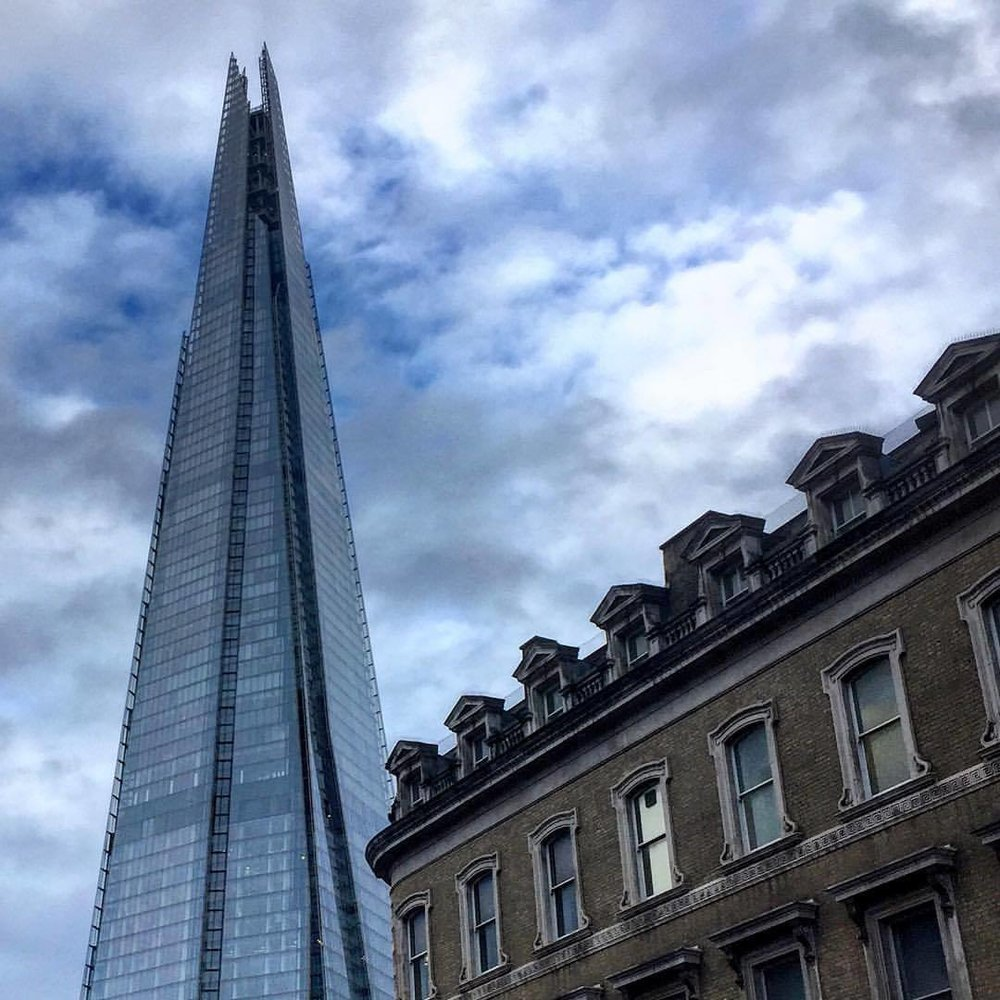 In the shadow of the Shard lies London's coexistence with the modern and the traditional.  #england #london #shard (at London Bridge Station)