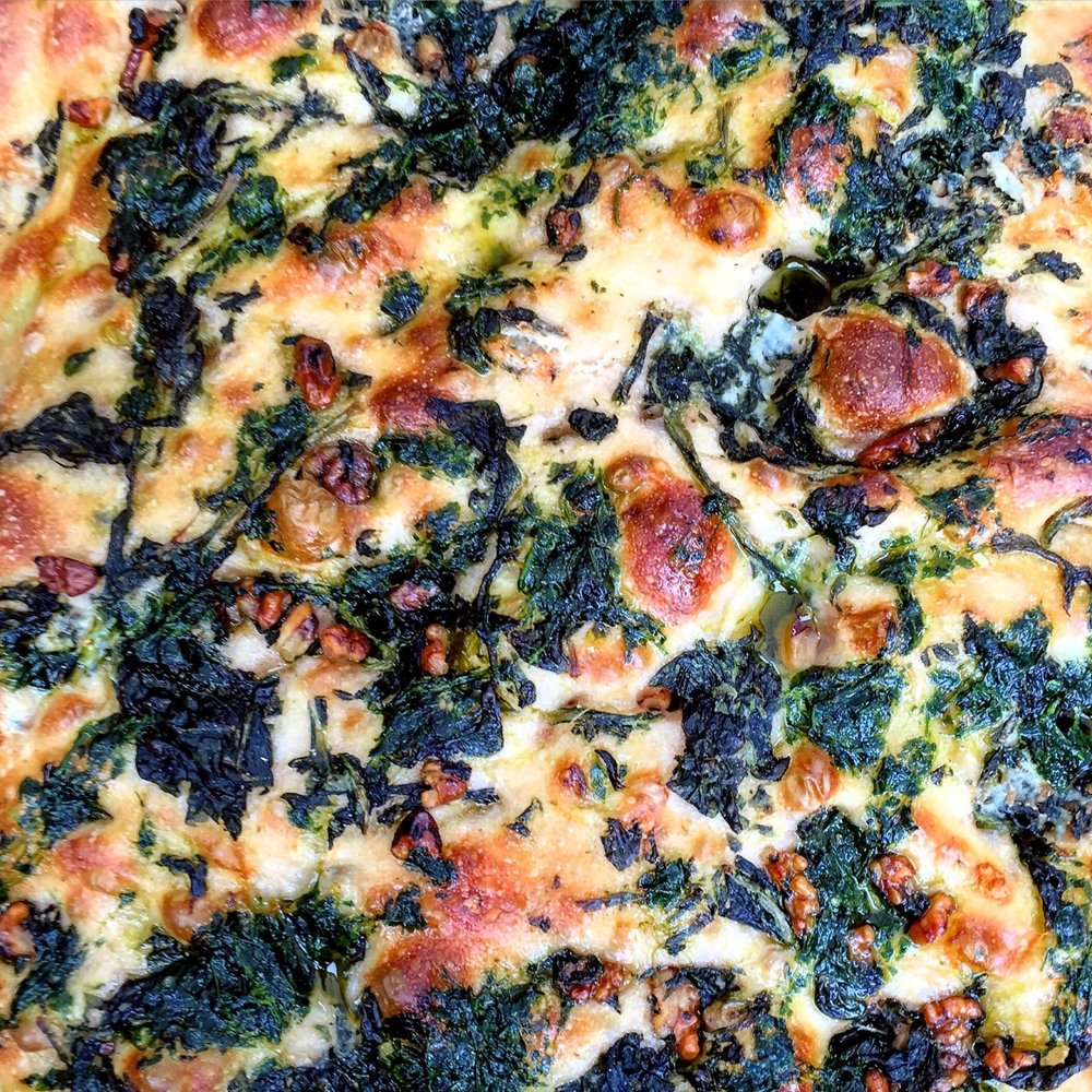 A slab of walnut, spinach and Gorgonzola focaccia from the Maltby Street Market.  London, England