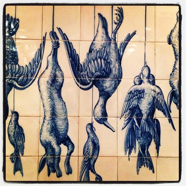 Early Portuguese ceramic tiles with hanging game at Rotisserie Georgette; flawless roasted bird with herbs de Provence and not-too-crispy, crispy frites. (at Rotisserie Georgette)