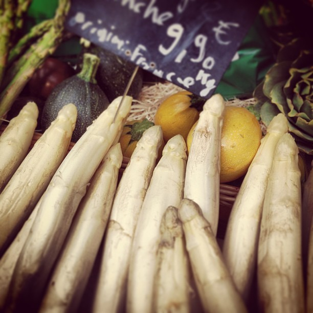The glorious white asparagus on offer at nearly every market in Paris in late spring and early summer.  While growing, soil is constantly heaped on top of the plant so it doesn't see the light of day and doesn't produce chlorophyll which turns the stalks green… (at Marché des Enfants Rouges)