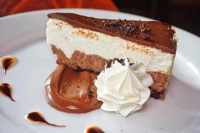 We hope you saved room for dessert! Our Mousse Cake is the perfect combination of chocolate & vanilla deliciousness. 😍😁 #HuntingtonVillage #LongIsland #BlackAndBlueSeafoodChophouse.