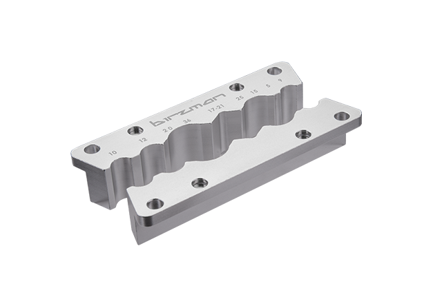 Axle & Spindle Vise Insert - Features built-in magnets to hold the Insert in place during bench vise use. Compatible with axles, spindles, hydraulic hoses, and Birzman Lockring sockets.
