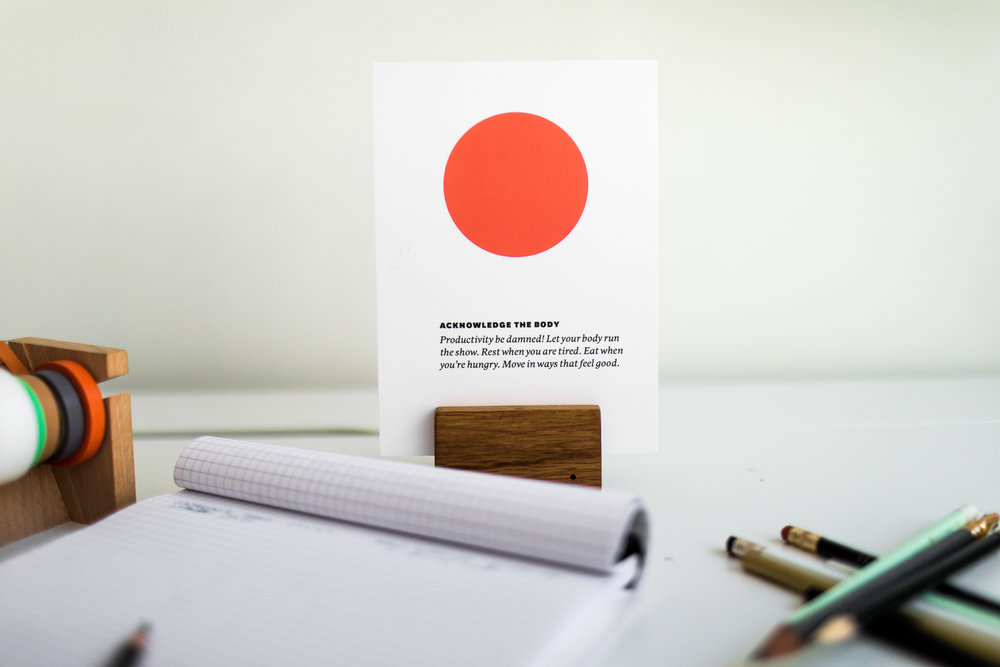 ORA+CLE is an object as well as a tool. Seen here, placed on a desk, as a reminder.