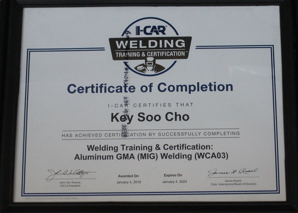 cho's body shop certifications.JPG
