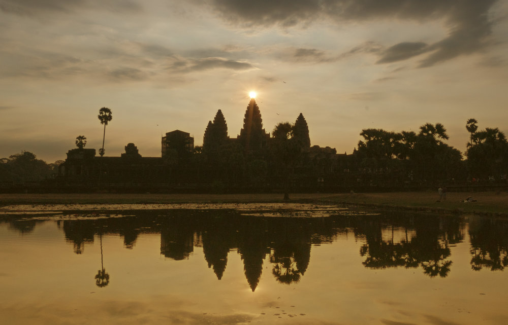 Angkor Wat at sunrise. We were lucky as the sun rises right behind the central tower only a few days a year.