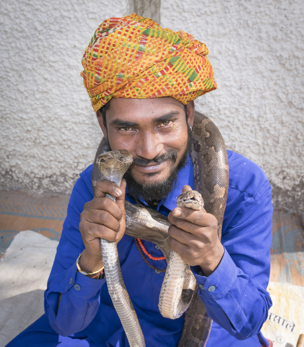 Snake Charmer with python and cobra. Our guide assured us they remove the cobra's fangs which eventually grow back.
