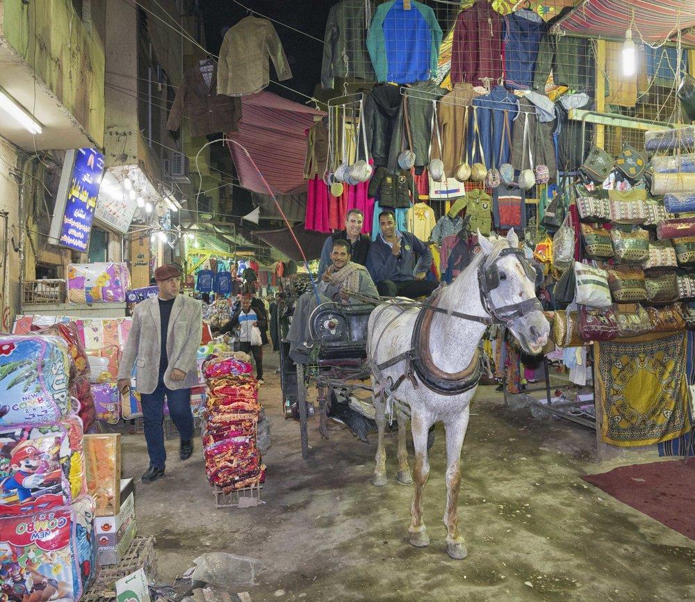 Riding through the bazaar.
