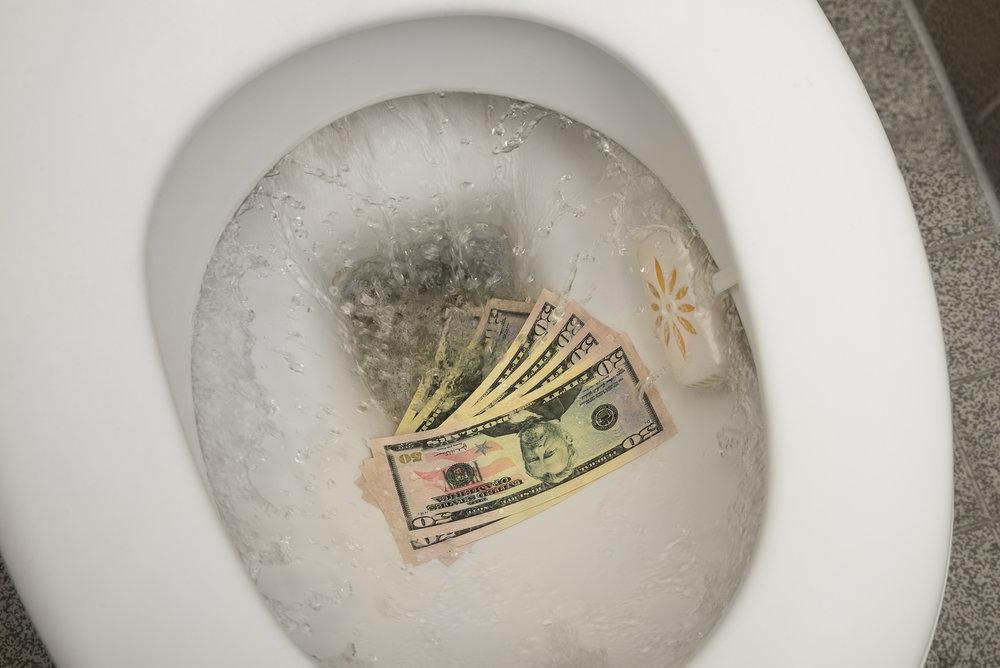 Flushing-Money-Down-The-Toilet.jpg
