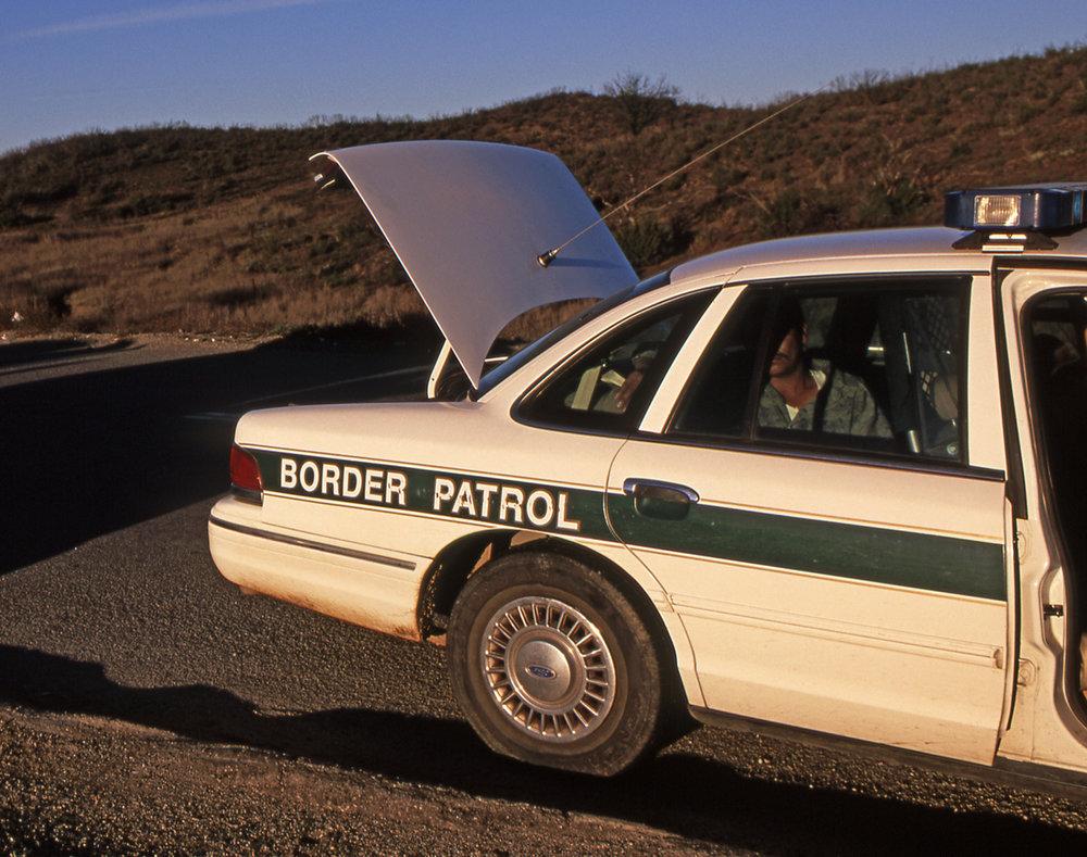 bigstock-Border-Patrol-Car-With-Suspect-1518588.jpg