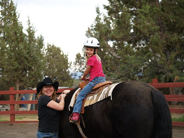 therese-with-kid-on-horse.jpg