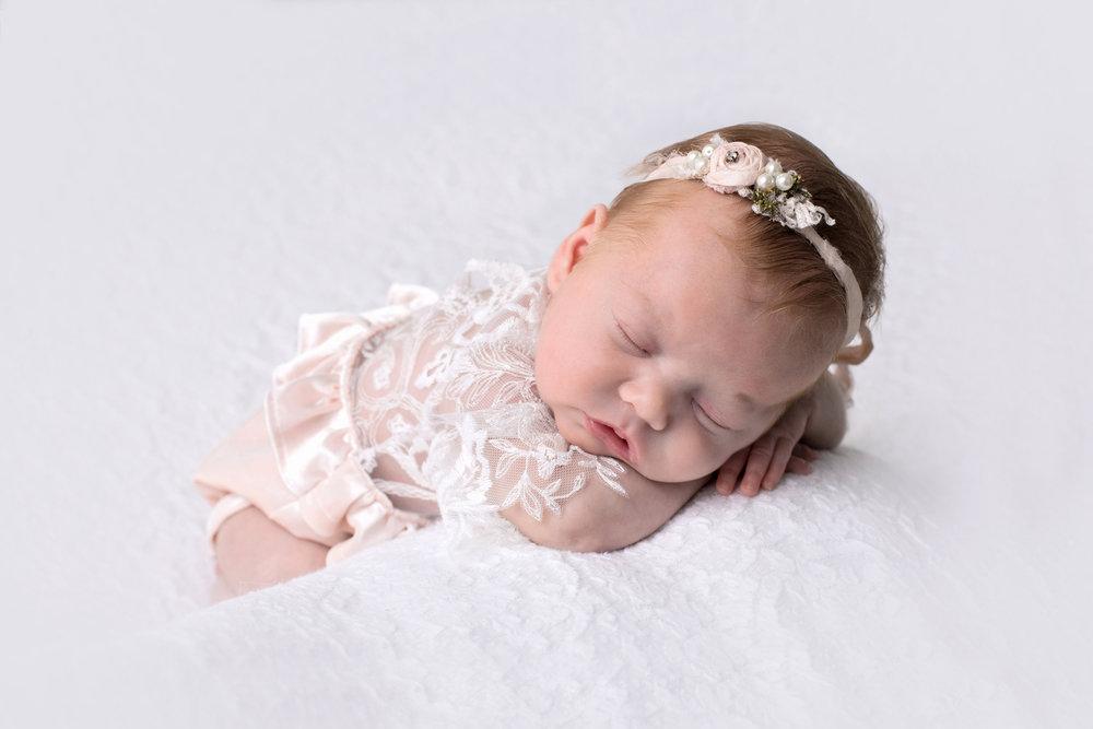Newborn girl velvet romper.jpg