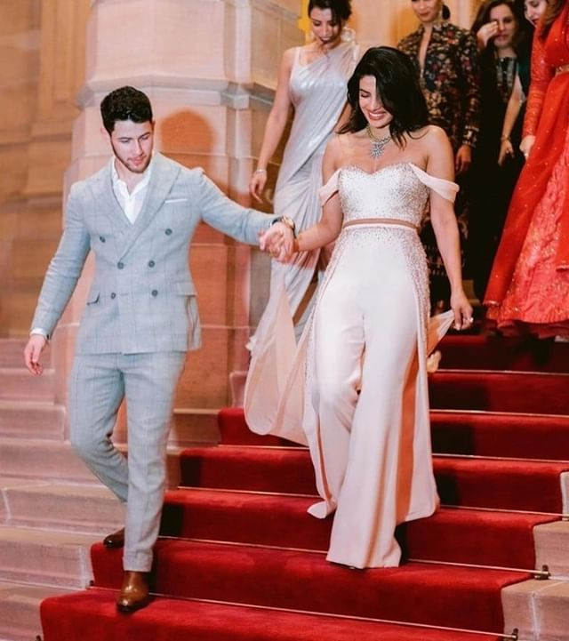 Magical wedding style by @ralphandrusso! Are you wearing a second look after your ceremony?⠀⠀⠀⠀⠀⠀⠀ .⠀⠀⠀⠀⠀⠀ ⠀⠀⠀ Bride & Groom @priyankachopra and @nickjonas / Photo @josevilla / #Repost @popsugar ⠀⠀⠀⠀⠀⠀ .⠀⠀⠀⠀⠀⠀⠀⠀⠀ .⠀⠀⠀⠀⠀⠀⠀⠀⠀ .⠀⠀⠀⠀⠀⠀⠀⠀⠀ #SecondLook #WeddingStyle #WeddingJumpSuit #Bride #CoolBride #CoolGirlStyle #GirlBoss #BrideVibes #Yaas #BridalStyle #LoveThem #SoGood #ChicBride #Beautiful #WeddingInspo #Engaged #Weddings #WeddingGoals #CoupleGoals #Love #Yes #IDo #Brides #This #Groom