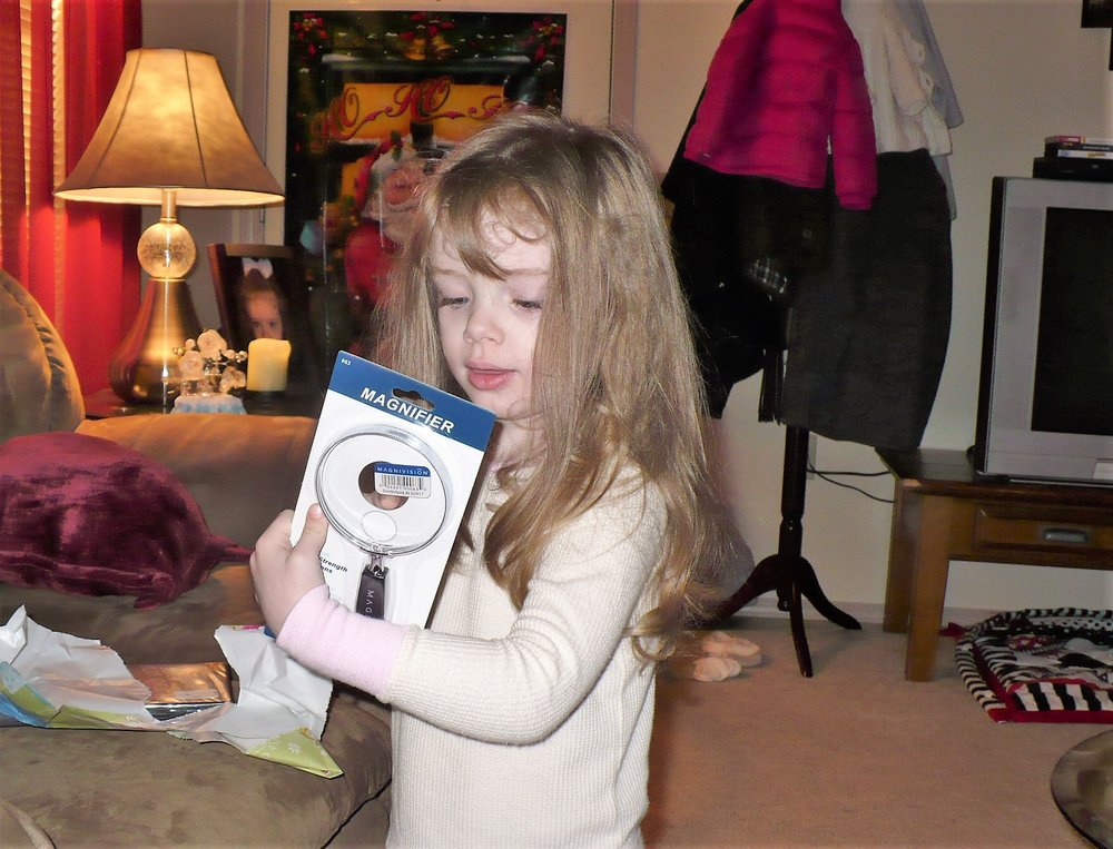 Christmas morning, 2009. She was so proud of that magnifying glass