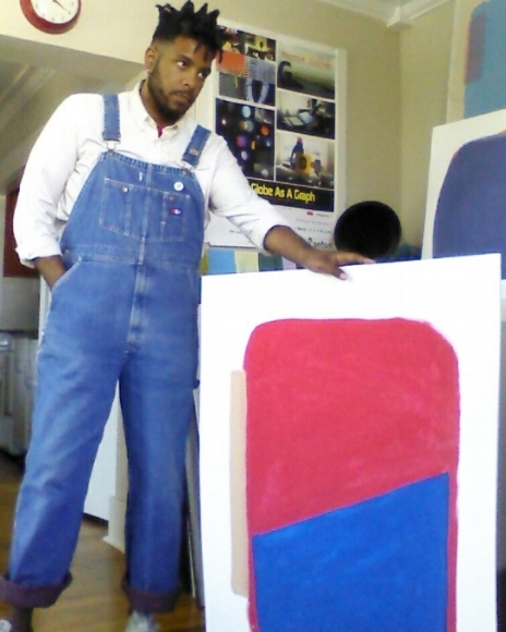 Marcus Cotten and his painting, in his apartment in Portland, 2018.
