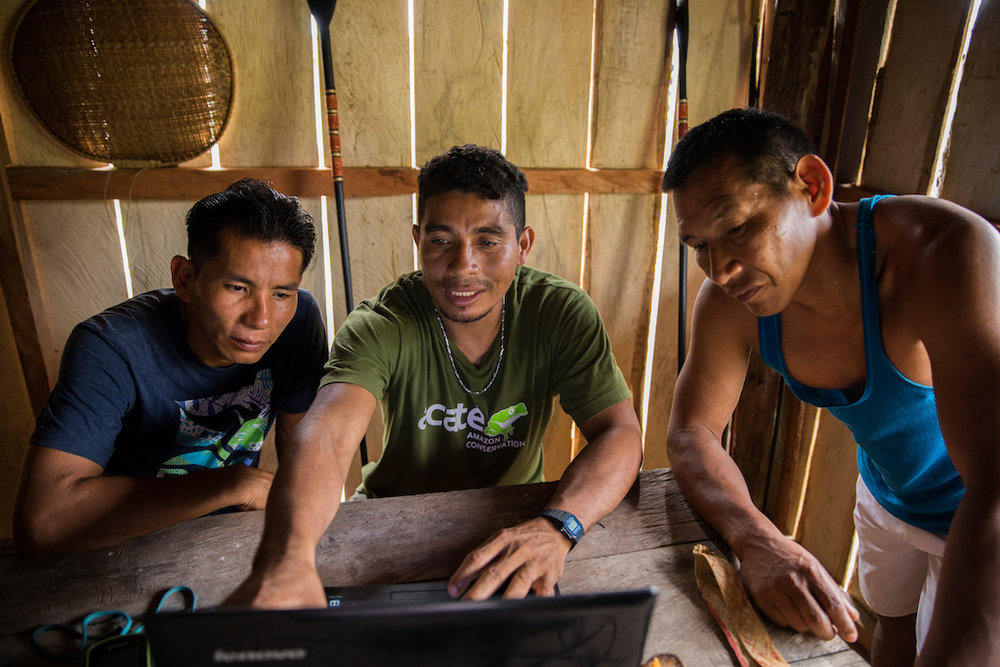 Felipe (centre) leads the project, having learnt the software through training workshops.