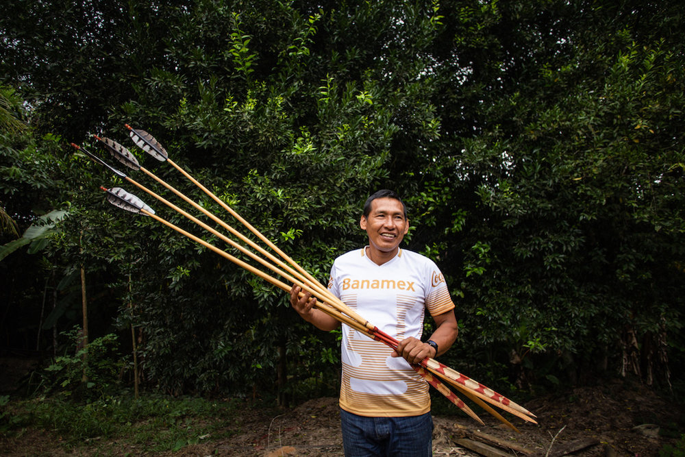 Segundo picking up a new batch of harpy eagle feathered arrows.
