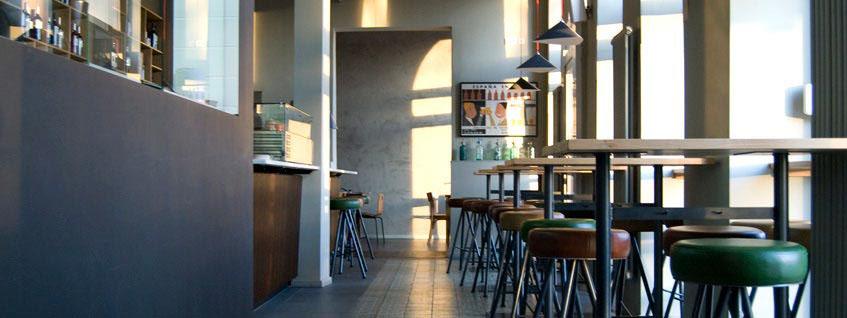 Bar stools at bar and interior view of Bar Raval Berlin