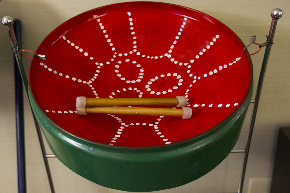 Asaf's drum made from a recycled trash can is the only instrument they brought with them from Puerto Rico.