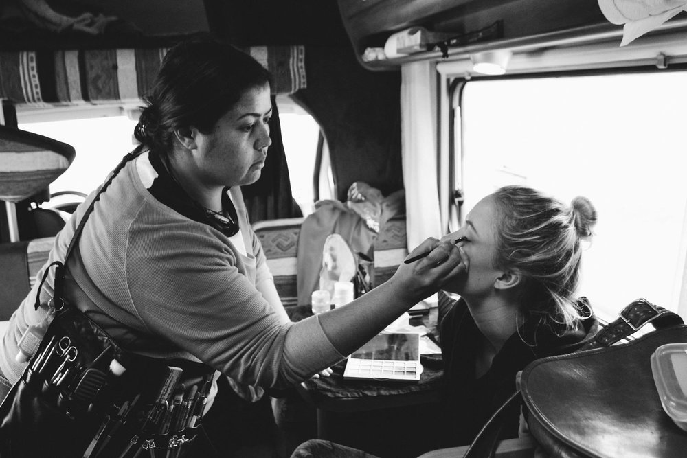 margaret, head of makeup and fx, preps maika before a scene