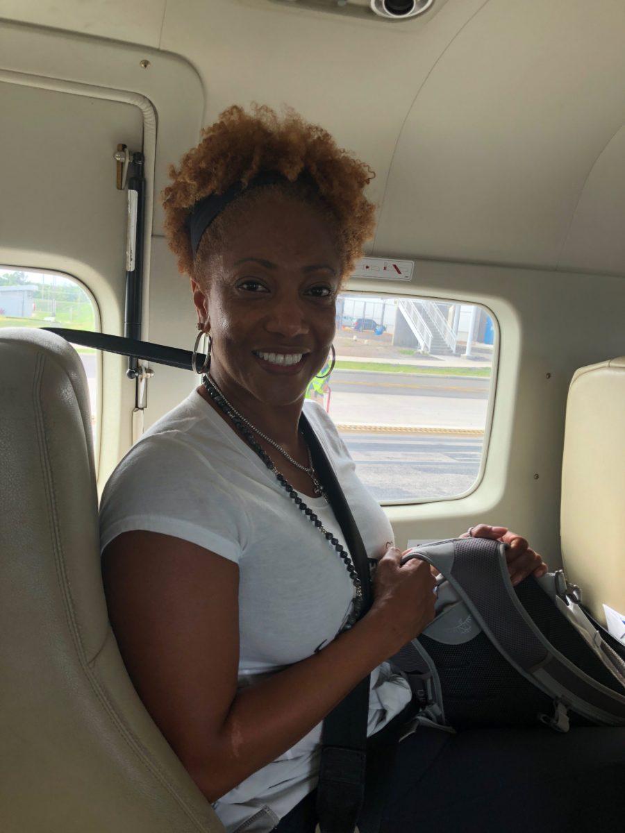 Tonya-on-the-plane-e1533831827987.jpg