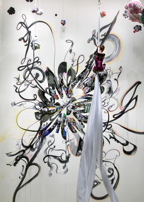 "- Shinique Smith (B.1971 in Baltimore, MD), is a New York based artist known for her mixed media painting, sculptural, and installation works, of fabric, calligraphy and collage, inspired by the vast nature of 'things' that we consume and discard, which resonate on a personal and social scale. The Graffiti of her youth, Japanese calligraphy, and Abstraction are among the influences from which she extracts ""the graceful and spiritual qualities in written word & the everyday."" Her work has also been exhibited at the Brooklyn Museum of Art, Corcoran Gallery of Art (Washington DC), Denver Art Museum, The Detroit Institute of Arts, Los Angeles County Museum of Art, Madison MOCA, The Bronx Museum of the Arts, MOCA (North Miami), The Museum of Fine Arts (Boston), National Portrait Gallery (Washington DC), The New Museum (New York), MOMA/PS1 (New York), The Rubell Family Collection (Miami), and Studio Museum in Harlem (New York). Smith's work is in the permanent collections of The Museum of Fine Arts (Boston), LACMA, Brooklyn Museum of Art, Denver Art Museum, and the Whitney Museum of American Art, among others, as well as in numerous private collections worldwide. The artist has had more than 20 solo exhibitions, most recently at MOCA Jacksonville (Florida) and at The Frist Center for the Arts in Nashville, who released a comprehensive exhibition catalogue with Vanderbilt Press in October of 2016. Presentations of her work have recently been exhibitied in the 8th Busan Biennale in Korea (2016) and the 13th Bienal de Cuenca in Ecuador (2016). She has received awards and fellowships from the Louis Comfort Tiffany Foundation, the Joan Mitchell Foundation, New York Foundation for the Arts, Skowhegan School of Painting and Sculpture, Vermont Studio Center, the Headlands Center for the Arts and the Lower Manhattan Cultural Council. Smith earned an MFA from Maryland Institute College of Art (2003), an MAT from Tufts University & The Museum School (2000) and a BFA (1992) from Maryland Institute College of Art, where she also served on the Board of Trustees (2013-2016). Her work is represented by Brand New Gallery, Milan and David Castillo Gallery in Miami.Image: Quickening; Mirror, acrylic, collage, fabric, objects, ribbon and rope; Aerialist performance collaboration with Bittersweet Studios for her Project Atrium installation 