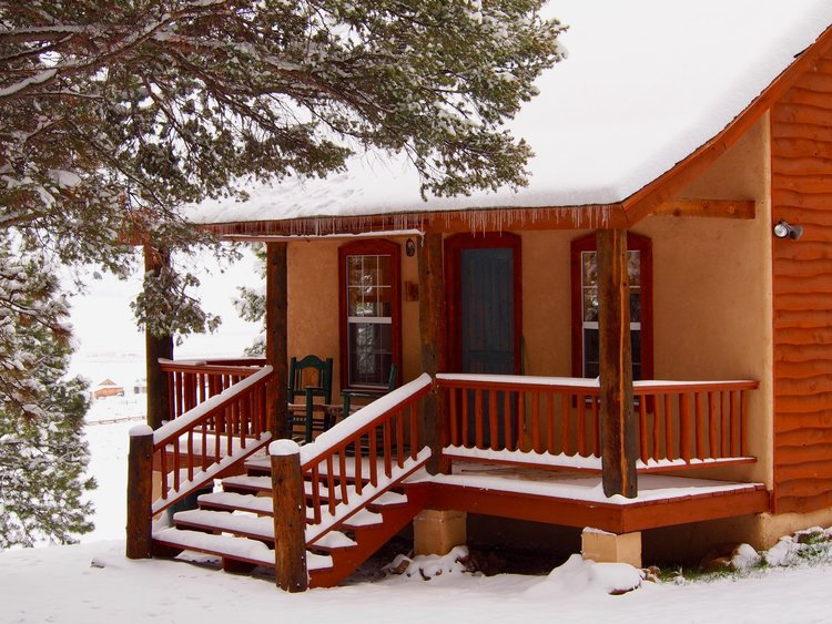 Nest Cabin/Forest Cabin - The Nest and Forest Cabins have a real woodsy feel, nestled among the great Ponderosa pines and overlooking the Moreno Valley. A huge eagle's nest is located just beyond the front porch! These are sister cabins (duplex style) that can be arranged to adjoin, or be occupied separately as individual units. The beds on each side can be arranged as a king or separated into two twins as preferred. Includes sofa sleeper on each side.- 1 Bedroom, 1 and a half Baths on each side- Gathering area and Mini Kitchen on each side- 2 Propane fireplaces on each side- Each has private covered deck/porch entryway with gas grill- 1120 sq ft (total for structure- Sleeps up to four on each side or eight total! Learn More!