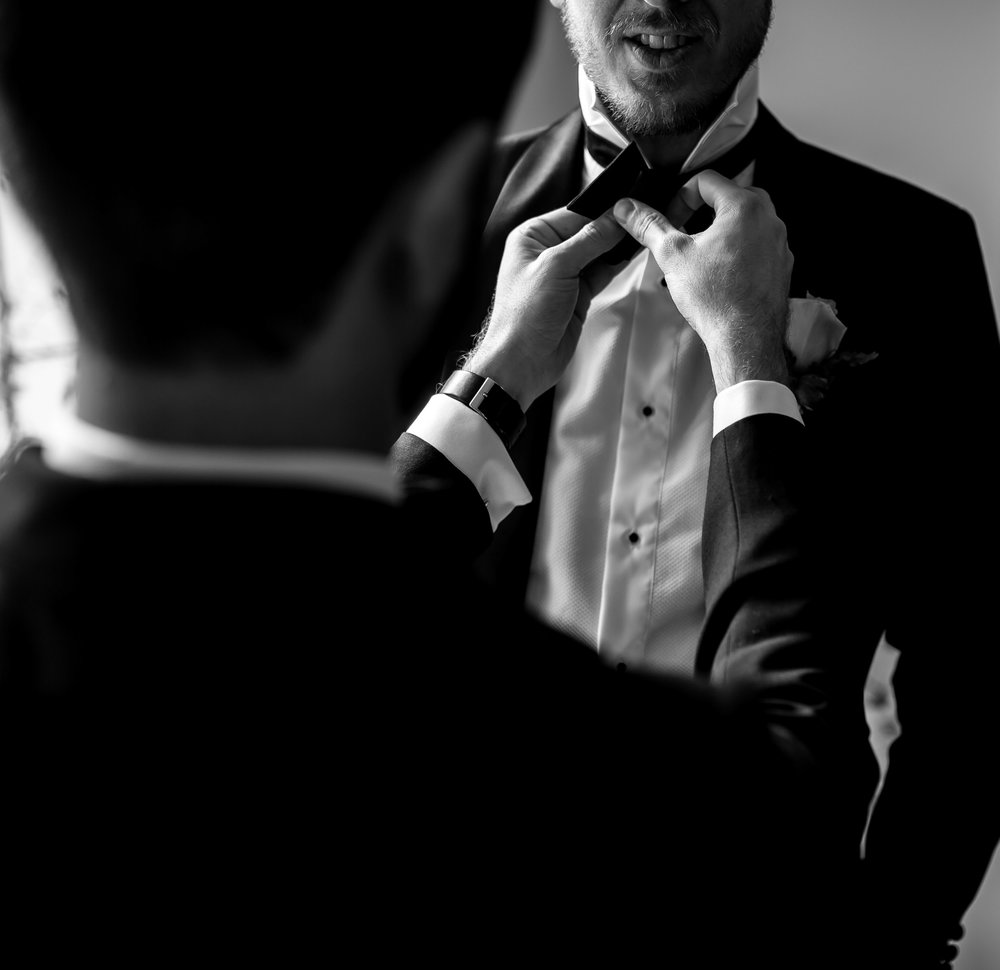 THE GROOM - Reece wore a classic black tuxedo from Oscar Hunt.