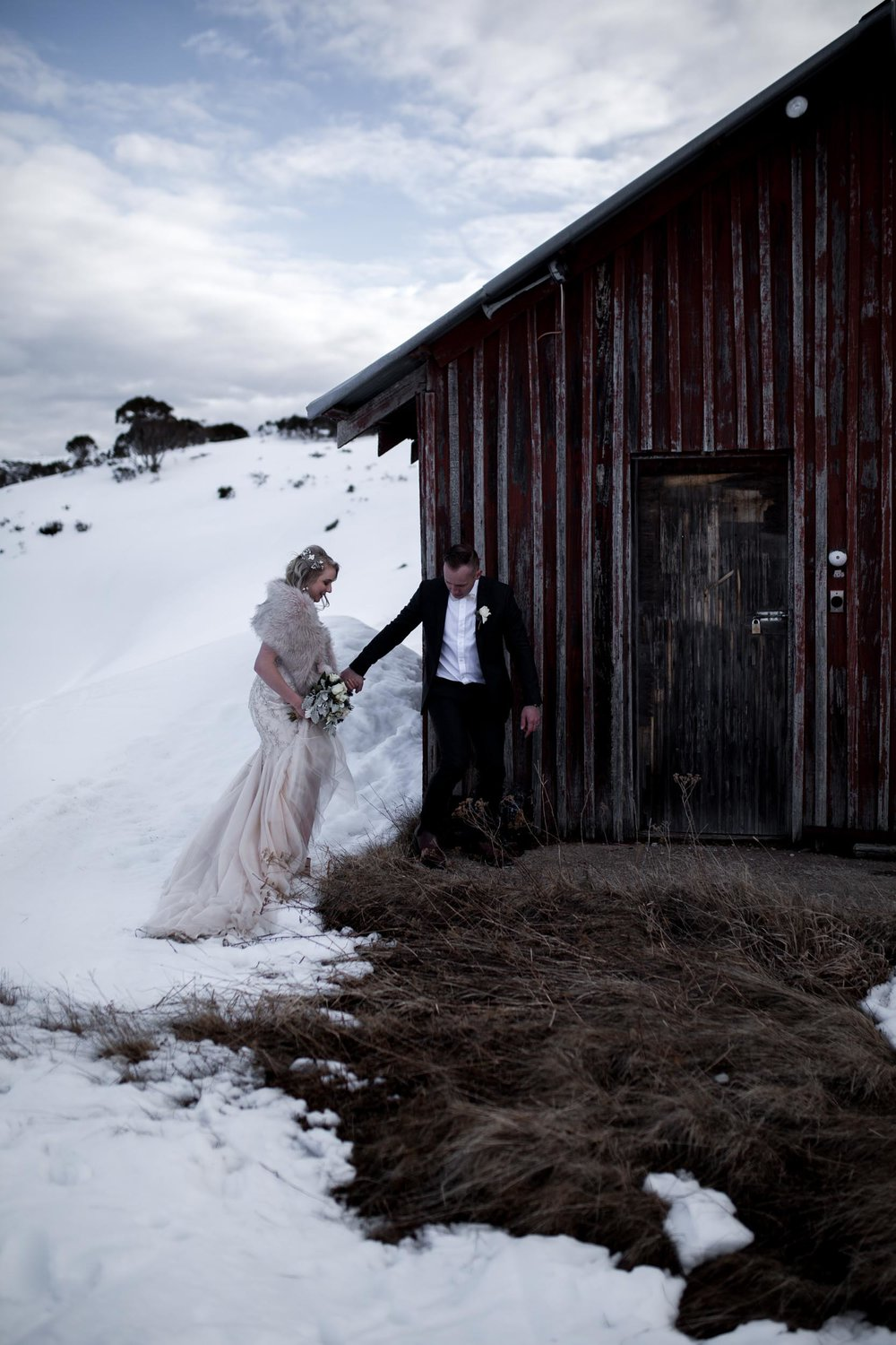 THE VENUE - Every little detail of Aimee & Adam's Springtime snow wedding was thought out carefully with the guests comfort in mind. They were provided a personalised hessian bag with a pair of black gum boots inside and were transported up to the ceremony via warm snowmobiles in true Falls Creek style.