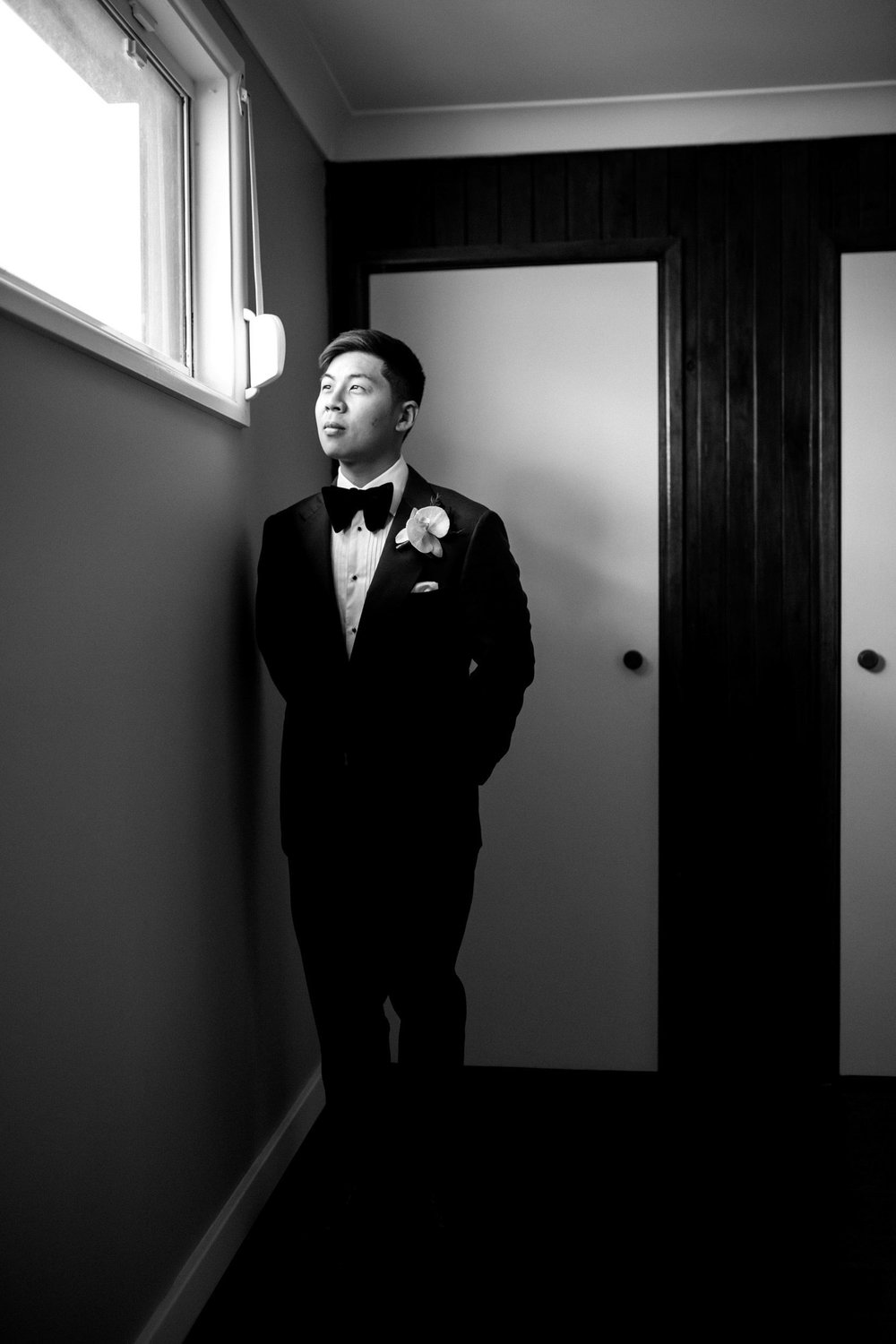 THE GROOM - Dennis looked dapper in a classic tuxedo by P Johnson Tailors.