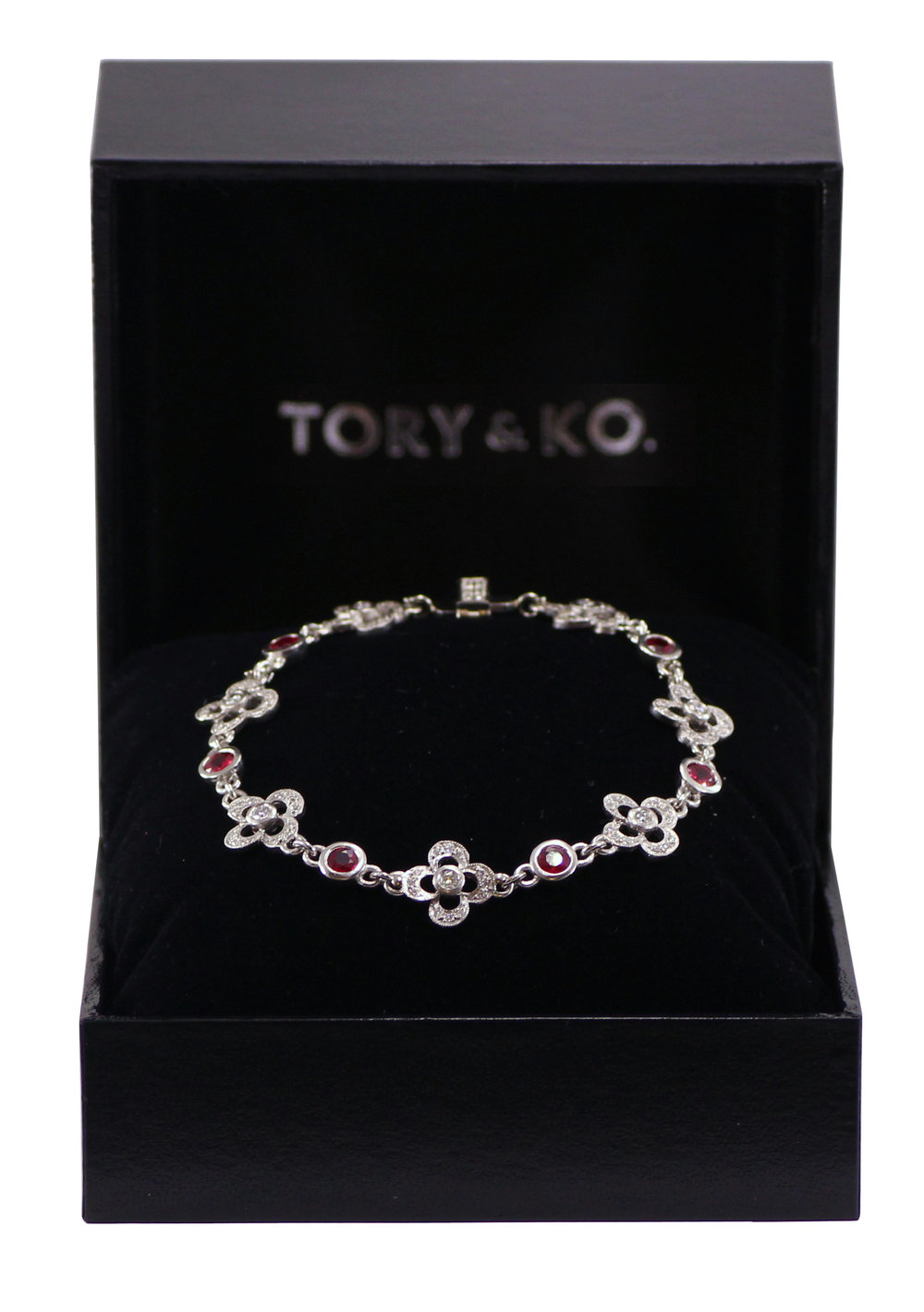 Ruby and diamond Flower bracelet.jpg