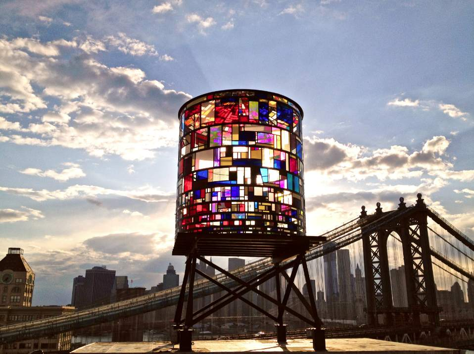 """5. Tom Fruin Water ToweR - I have driven by this """"not-so-hidden"""" stained glass water tower dozens of times and each time I'm blown away by how it's colorful beauty stands out in the city of lights. If you're planning a trip to NYC this is worth a visit or photo opportunity. You can find it situated on the rooftop of 20 Jay Street and it's viewable from some other desirable destinations such as the parks and streets of Dumbo, the Brooklyn and Manhattan Bridges, FDR Drive and Lower Manhattan. For the best views, try Brooklyn Bridge Park at Washington Street and the Manhattan Bridge bike path."""