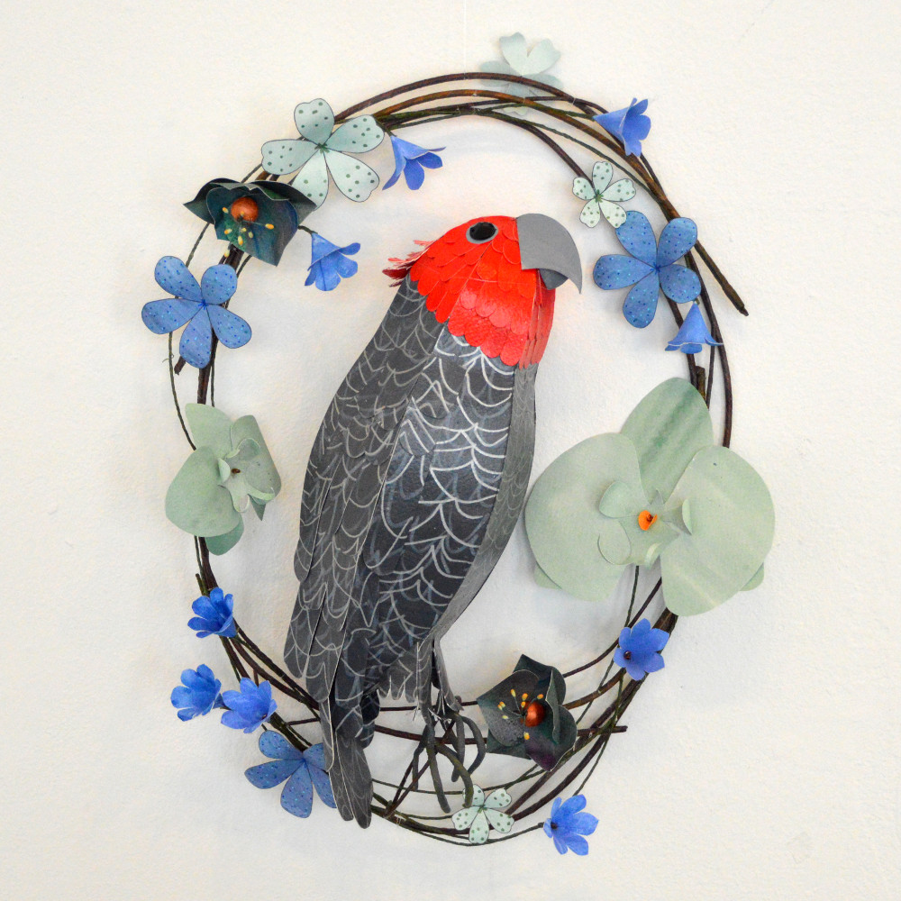 Ruadhri the Gang Gang Cockatoo, perched on an oval wreath