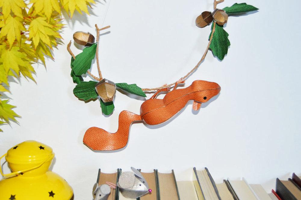 squirrel pup sculpture on acorn branch 2.jpg