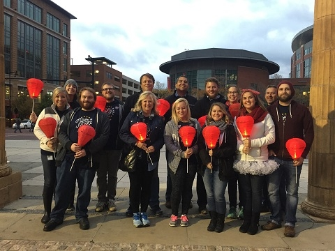 NEP volunteers carry red lanterns in support of blood cancer research.