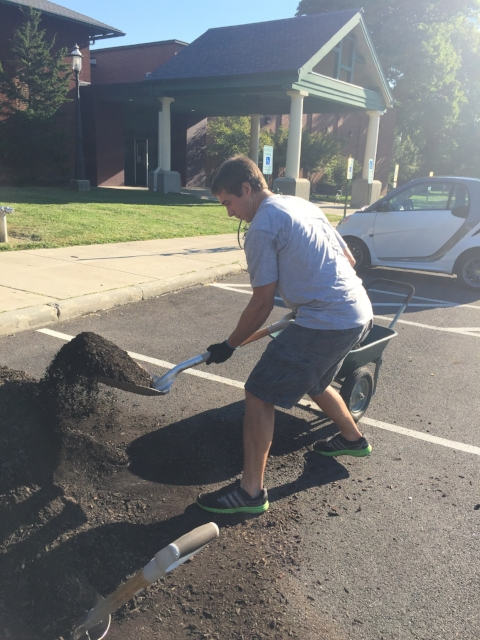 NEP volunteer John Mosny gathers mulch.