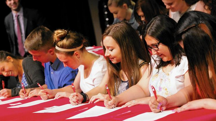 Determined to recruit and support the next generation of teachers for local schools, officials at Township High School District 214 recently launched an Educator Prep initiative. Pictured here are students signing up for the program at its May 26 launch. Karen Ann Cullotta / Pioneer Press. May 31, 2016. (Township High School District 214 / Handout)