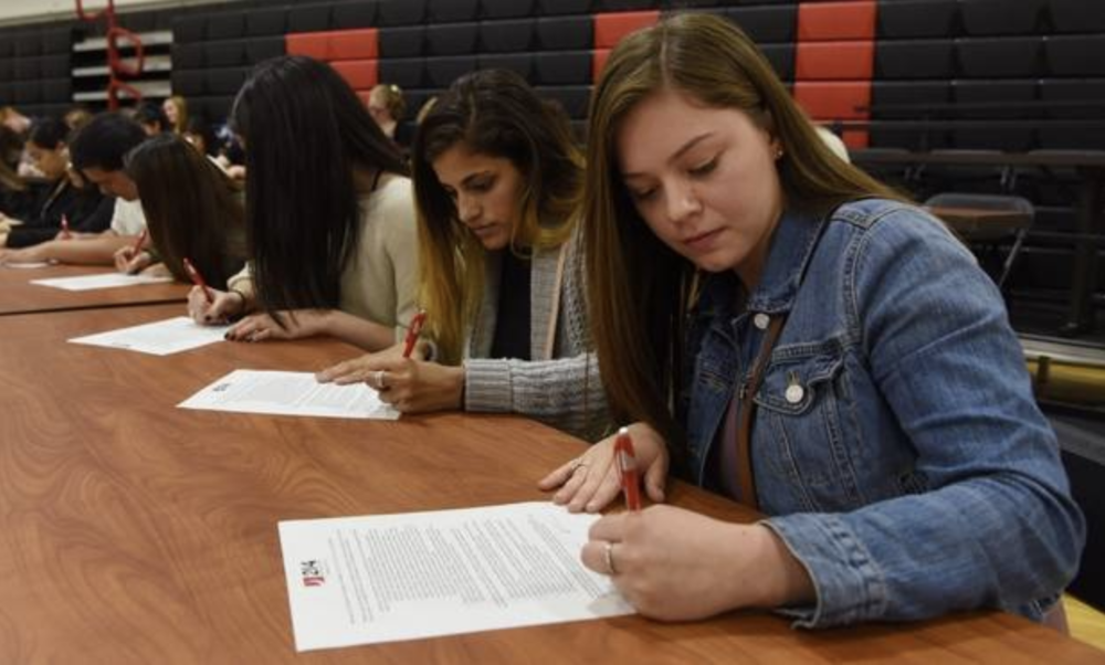 Signing day to become teachers for 110 District 214 students. Doug T. Graham / Daily Herald. May 11, 2017 (Joe Lewnard / Staff Photographer)