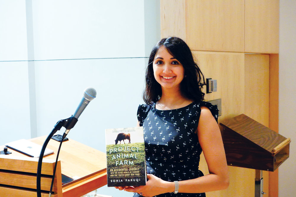 PICTURED, above: Sonia Faruqui reads from her book Project Animal Farm at an event.