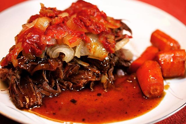 【Mom's Pot Roast】 ・ *********************** 【Ingredients (8 servings)】 4 lbs. beef shoulder roast 2 ½Tablespoons Worcestershiresauce 1 ½teaspoons ground black pepper 2lbs. onions, peeled, halved, and cut into ¼-inch slices 1½lbs. carrot, peeled andcut into 1-1 ½inch pieces 24 oz. ketchup 1 ½cups water 2 Tablespoons cornstarch mixed with 3 Tablespoons cold water *********************** ・ 【Directions】 1.Rub the Worcestershiresauce on both sides of the beef.  Sprinkle with ground black pepper.  Allow beef to rest at room temperature for around 30 minutes to give it time to absorb the Worcestershiresauce. 2.Place roast inaheavy roasting pan.  Place the pan in a 450°F oven and cook until browned. (If possible, a 450°F convectionoven is ideal.) 3.When browned, top the beef with onion slices and then ketchup.(If some of the onions fall around the sides of the beef, that is fine.) 4.Place thecarrotsaround the roast.  Pour the water around the roast. 5.Cover tightly with aluminum foil and continue cooking in a 350°F oven (non-convection). The roast will take 3-4 hours depending on the thickness and tenderness of the meat. It is done when the meat is very tender. 6.Remove the aluminum foil and continue cooking for 15 minutes. 7.Remove the pan from theoven.  Ladle the cooking liquid into a sauce pan. 8.Bring the liquid to a boil and skim to remove any excess fat.  9.While whisking, add the cornstarch slurry a little at a time, allowing the liquid to boil with each addition. Add only enough to thicken the liquid to your taste. It may not be necessary to add all of the cornstarch slurry.  Taste for seasoning. 10.Serve.  #umamirecipes #umami #recipes #foodrecipes #cook #foodcooking #foodie #foodstagram #foodporn #ajinomoto #food52grams #cookingram #beef #deliciousness #worcestershiresauce #hotpot #foodphotography #foodgasm