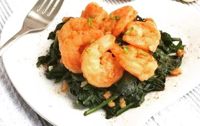 【Garlic Shrimp over Sautéed Spinach】・ This Garlic Shrimp over Sautéed Spinach is table ready in 20 minutes with less sodium thanks to MSG!  Attribution:@laurenpincusrd *********************** 【Ingredients (4 servings)】 ・ Garlic Shrimp 1 Tablespoon olive oil or avocado oil 1 pound extra large raw shrimp- approximately 26-30 (fresh or frozen, thawed, peeled and deveined) 10 cloves garlic, peeled and chopped 1/8 teaspoon table salt Sprinkle of Ac'cent (MSG) 1/2 teaspoon paprika red pepper flakes to taste・ Spinach 1 Tablespoon olive oil or avocado oil 1 pound fresh baby spinach leaves, prewashed 4 cloves garlic, chopped 1/4 teaspoon salt 1/8 teaspoon Ac'cent (MSG) 1/2 teaspoon black pepper squeeze of lemon juice (about ¼ of a lemon) *********************** ・ 【Directions】 1.  Heat a sauté pan on medium heat. Add 1 Tablespoon oil and sauté garlic until fragrant but not brown, approximately 30 seconds. 2.  Add shrimp, salt and Ac'cent and stir frequently until shrimp is cooked through, approximately 2 minutes. 3.  Remove pan from heat and stir in paprika. 4.  Add red pepper flakes to taste-1/4 teaspoon suggested. 5.  While the shrimp is cooking, heat a separate large pot with a lid over medium heat. 6.  Add 1 Tablespoon oil and sauté remaining 4 cloves chopped garlic for about 30 seconds, do not brown! 7.  Add the spinach, salt, Ac'cent and pepper and cover to cook for about 2 minutes. 8.  Remove the lid, toss spinach to distribute the garlic and seasonings, and cook uncovered for an additional minute or until wilted. 9.  Add a squeeze of lemon juice and remove from heat. 10.  Use a slotted spoon to remove spinach from the pot, add to a serving dish and top with shrimp.  #umamirecipes #umami#recipes#foodrecipes #cook#foodcooking #foodies #foodstagram #foodporn #ajinomoto #food52grams #cookingram #MSG #shrimp #spinach #paprica #garlic #oliveoil #avocadoole #seafood #lemonjuice #deliciousness #msgisumami