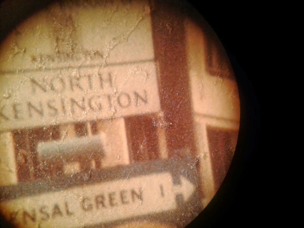 Detail, adhesive residue under stereoscopic microscope.