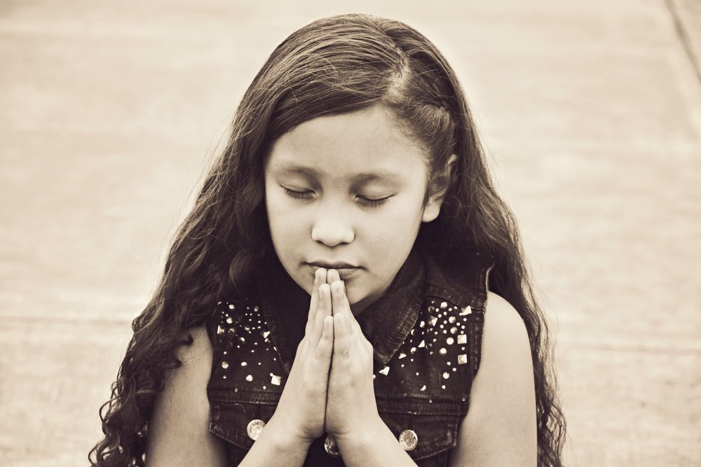 Praying Child Christian Stock Photo.jpg
