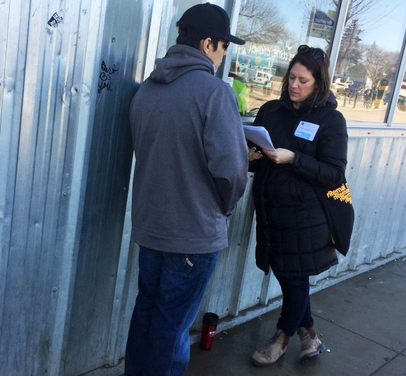 Jolene Zidkovich, right, conducts a survey as part of a point-in-time homeless count in Saskatoon on Wednesday, April 18, 2018. (Laura Woodward/CTV Saskatoon)