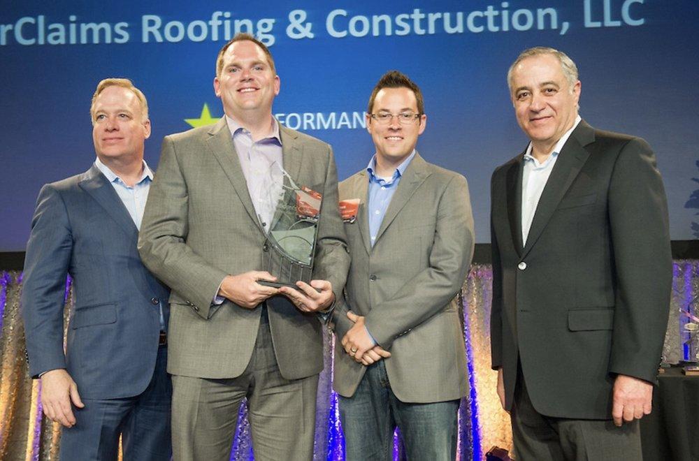 Receiving our GAF President's Club Award from former GAF CEO Bob Tafaro.