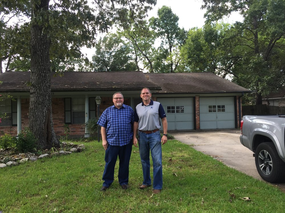 Justin and Ray after closing on the purchase of the new Woodlands office location in 2016 prior to remodel of the facility.
