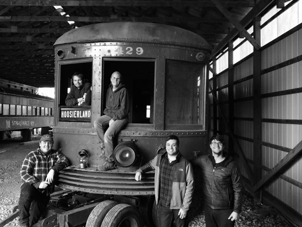 """Founding directors of the Hoosier Heartland Trolley Company pose with   Union Traction Company of Indiana interurban No. 429 """"Noblesville""""  , after its relocation to safety. No. 429 will be the feature of our first capital campaign and restoration project,  #Electrify429."""